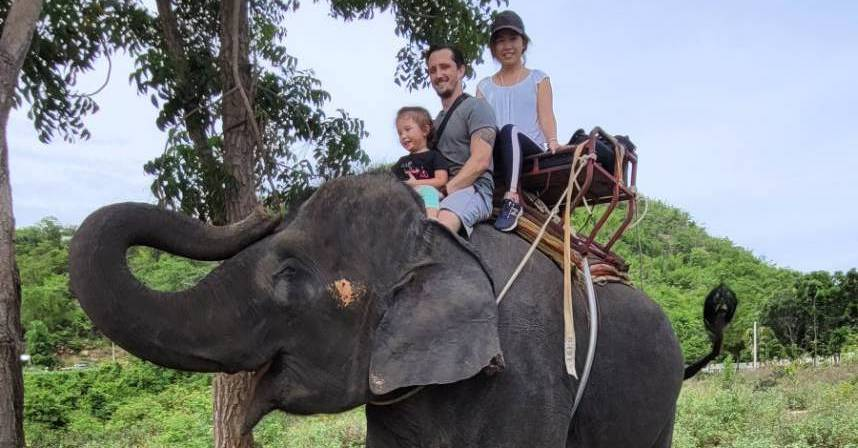 AADC diagnosis | AADC News | Richard E. Poulin and his wife and daughter ride on the back of an elephant in Thailand