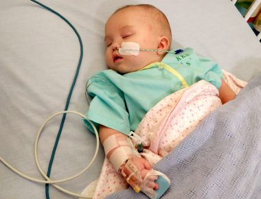 AADC diagnosis | AADC News | As an infant, Rylae-Ann, now 3, sleeps in a hospital bed connected to various tubes and cables